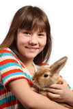 Girl with pet rabbit. Cute preteen girl with pet rabbit, isolated on white background