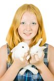 Girl with pet rabbits Stock Image