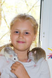 Girl with pet rat Stock Photo
