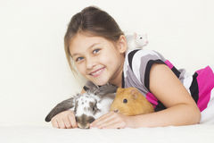 Girl with pets. A little girl with pets Stock Photo
