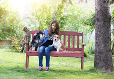 Girl with pets in park Royalty Free Stock Photo