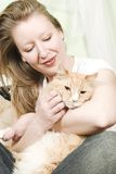 Girl petting cat Royalty Free Stock Image