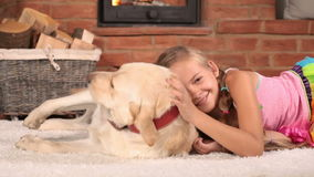 Girl petting her labrador dog stock video