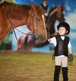 Girl petting horse Stock Photos