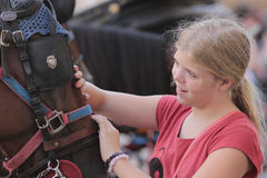 Girl petting a horse Royalty Free Stock Image