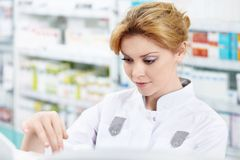 The girl at the pharmacy Stock Photo