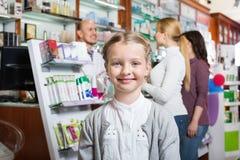 Girl in the pharmacy Royalty Free Stock Photos