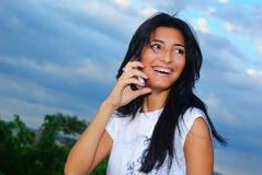 Girl and a phone Royalty Free Stock Photos