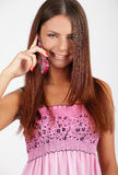 Girl with a phone. Girl speaking by a phone and smiling Royalty Free Stock Photo