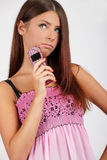 Girl with a phone. Girls with a phone in a pink dress Stock Photography