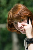 Girl with the phone Stock Photography