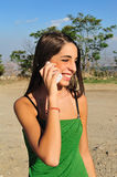 Girl with phone. The image may have great use for telephone companies and telecommunications colors like green and blue catturanol'attenzione of the beholder Stock Image