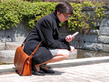 Girl with phone. In park Stock Photography