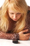 Girl and phone. Beauty girl and her black mobile phone Stock Photo