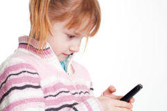 Girl and phone Royalty Free Stock Photo