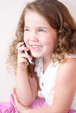 Girl with phone. Having fun on talking, little girl with phone Royalty Free Stock Photo