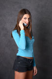 Girl with phone. Girl talk via cell phone Royalty Free Stock Image