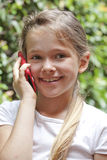 Girl with phone. A seven year old girl who used a smartphone Royalty Free Stock Photo