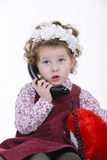 Girl at phone Stock Image