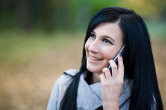 Girl on the phone. Smiling girl talking on the phone stock photos