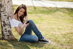 Girl with phone Royalty Free Stock Photo