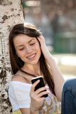 Girl with phone Royalty Free Stock Photography