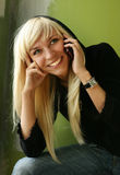 Girl with the phone Royalty Free Stock Photography