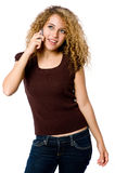 Girl On Phone. An attractive young woman with mobile phone on white background stock photos