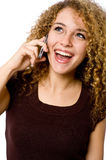 Girl On Phone. An attractive young woman with mobile phone on white background stock photography
