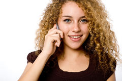 Girl On Phone. An attractive young woman with mobile phone on white background Royalty Free Stock Photos