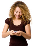 Girl With Phone. An attractive young woman with mobile phone on white background stock images