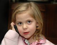 Girl On Phone. Young girl talking on a mobile phone stock images