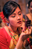 Girl with phone in Assam Stock Photography