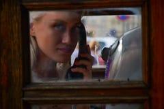 Girl in phone box stock photos