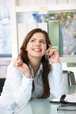 Girl on phone call in office Royalty Free Stock Photo