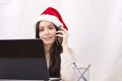 Girl with phone. And computer in Christmas Royalty Free Stock Images