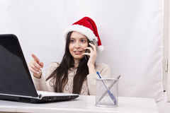 Girl with phone. And computer in Christmas Royalty Free Stock Photography