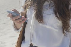 Girl with phone in her hand. stock photos