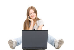 Girl with phone and laptop Royalty Free Stock Photo