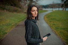 People and technology. Girl with a phone in nature Stock Photography