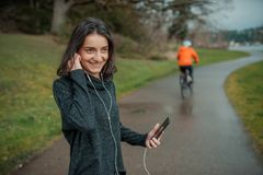 People and technology. Girl with a phone in nature Stock Image