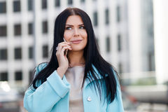 Girl with phone near building royalty free stock images