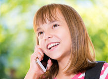 Girl with phone. Outdoor portrait of happy girl 10-11 year old talking on phone Stock Photography