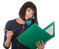 The girl with phone and reads documents. Stock Photo