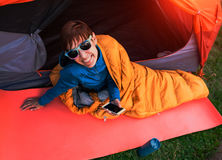 Girl with a phone in a sleeping bag. Stock Image