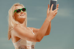 Girl with phone taking selfie. Royalty Free Stock Photo