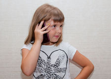 Girl and phone. Teen girl with phone in right hand Royalty Free Stock Image