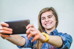 Girl with a phone Stock Photography