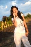 Girl,phone and vineyard Royalty Free Stock Photography
