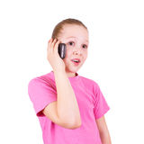 The girl on the phone on a white Royalty Free Stock Image